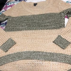 Knitted sweater top with a scoop V-neck.